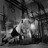 Crossfit fitness TRX push ups man workout  Fototapety do Siłowni Fototapeta