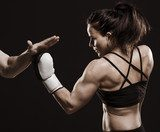 Beautiful fitness woman training boxing.  Fototapety do Klubu Fitness Fototapeta