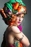 photo of redheaded girl in a head-dress from the coloured fabric  Pin-up Obraz