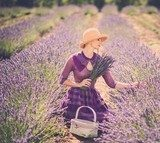 Woman in purple dress and hat with basket in lavender field  Prowansja Fototapeta