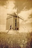 Old wooden windmill. vintage image of old buildings  Sepia Fototapeta