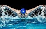 Muscular young man in blue cap in swimming pool  Sport Fototapeta
