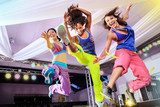 young women in sport dress jumping at an aerobic and zumba exerc  Sport Fototapeta