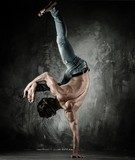 Young b-boy man with naked torso doing brake dancing movements  Sport Fototapeta