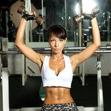 Fitness model trains in the gym  Sport Fototapeta