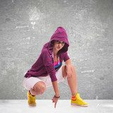 woman dancer wearing a hoodie  Sport Fototapeta