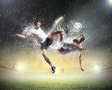 two football players striking the ball  Sport Fototapeta