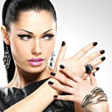 Beautiful fashion sexy woman with black nails at pretty face  Obrazy do Salonu Kosmetycznego Obraz