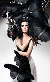 Woman with black hair and art make up and butterflies  Motyle Fototapeta