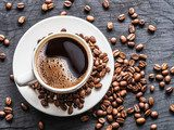 Cup of coffee surrounded by coffee beans. Top view. Fototapety do Kawiarni Fototapeta