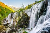 Beautiful view of the Pearl Shoals Waterfall and woods at sunset Wodospad Fototapeta