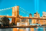 New York night view of the Lower Manhattan and the Brooklyn Bridge across the East River. Mosty Obraz