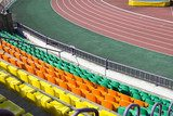rows of plastic seats at stadium  Stadion Fototapeta