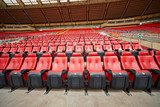 Rows of red armchairs at stadium  Stadion Fototapeta