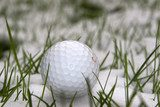 a lone single golf ball in the snow  Sport Fototapeta