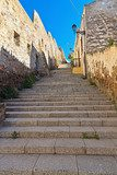 stairway and ancient walls in Carloforte  Schody Fototapeta