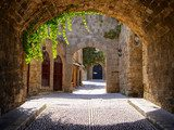 Medieval arched street in the old town of Rhodes, Greece Uliczki Fototapeta