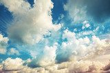 Bright blue cloudy sky, vintage toned photo background Niebo Fototapeta