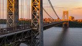 The George Washington Bridge (long-span suspension bridge) across the Hudson River at sunset. Uptown and Fort Washington Park, New York City, USA Mosty Obraz