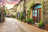 Flower filled streets of the old Italian city in Tuscany. Uliczki Fototapeta