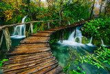 Deep forest stream with crystal clear water with wooden pahway. Plitvice lakes, Croatia UNESCO world heritage site Krajobraz Fototapeta