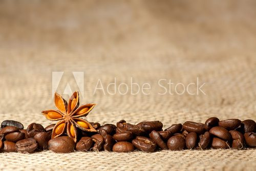 Coffee and Star Anise on sackcloth background with copyspace  Fototapety do Kawiarni Fototapeta