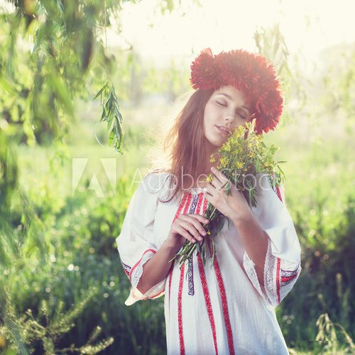 Emotional portrait of ukranian woman with bouquet of flowers  Folklor Fototapeta