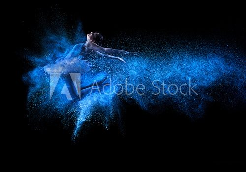 Young beautiful dancer jumping into blue powder cloud  Ludzie Obraz