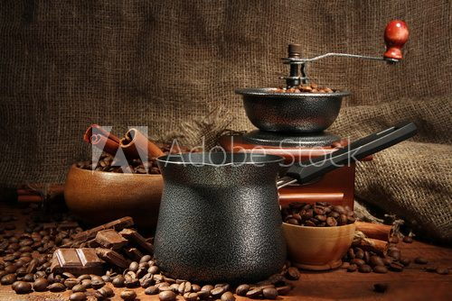 Coffee grinder, turk and cup of coffee on burlap background  Kawa Fototapeta
