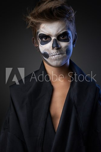 Teen with make-up of skull in black cloak unhappy  Ludzie Obraz