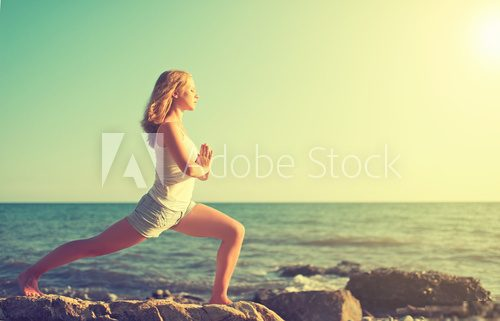 young woman doing yoga on  beach  Fototapety do Klubu Fitness Fototapeta