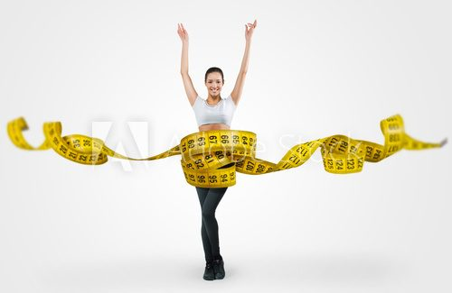 Fit young woman with a large measuring tape  Fototapety do Klubu Fitness Fototapeta