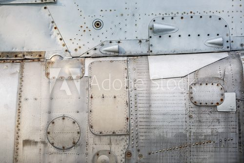 Abstract metal background. Old weathered silver metallic background. Vintage metal texture with rivets and bolts. Sheathing old plane. Old metal texture. Industrialne Fototapeta