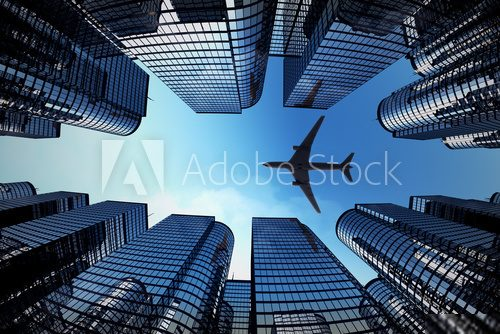 Business towers with a airplane silhouette  Architektura Plakat