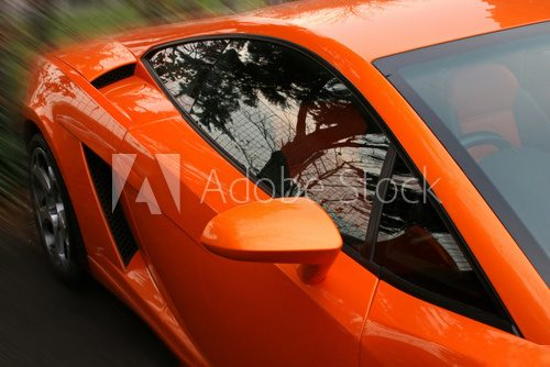 side of orange supercar  Pojazdy Obraz