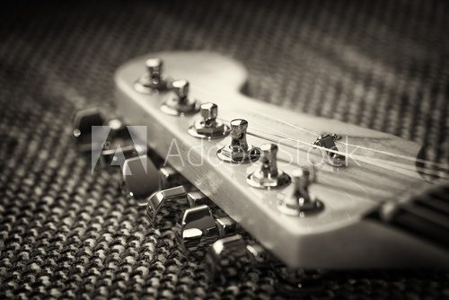 Electrical guitar headstock closeup. Sepia effect with vignette  Muzyka Obraz