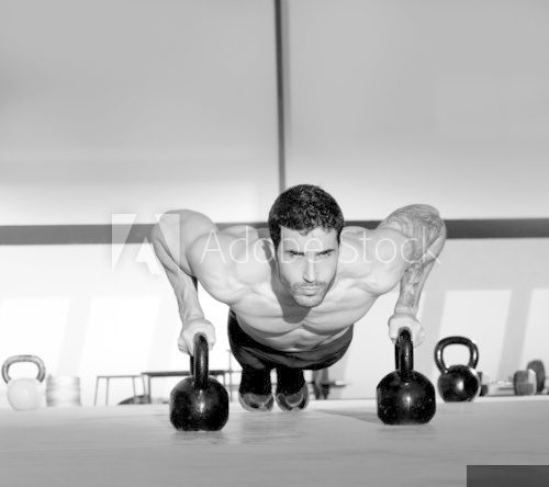 Gym man push-up strength pushup with Kettlebell  Fototapety do Siłowni Fototapeta