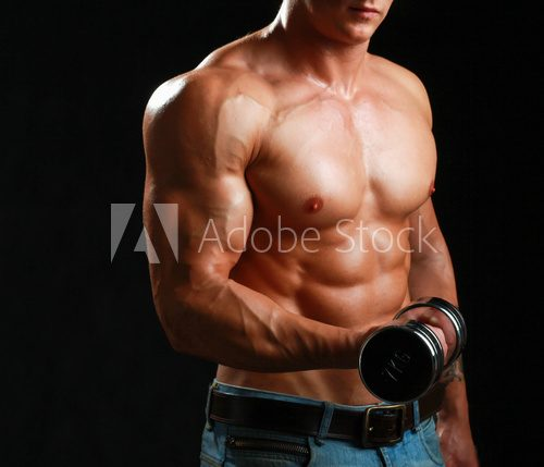 Handsome muscular man working out with dumbbells  Fototapety do Siłowni Fototapeta
